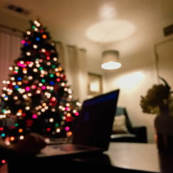Christmas Tree with lights in background of room